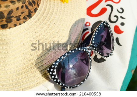 beautiful vintage glasses, hat, lady's bag - stock photo