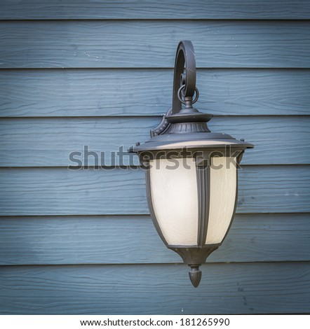 Beautiful Vintage lamp on the wall from Thailand - stock photo