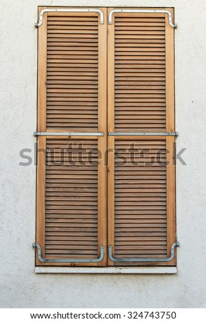 beautiful vintage shutters on the windows of the old house - stock photo