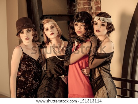 Beautiful Vintage Women celebrating at a gathering posed looking at camera - stock photo
