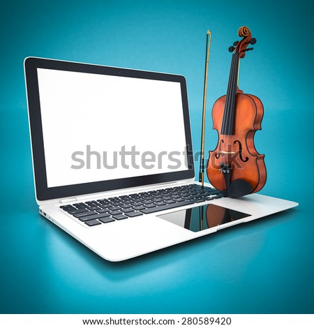 beautiful violin and white laptop on a blue background - stock photo