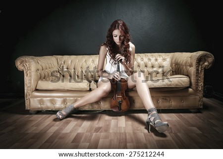 Beautiful violinist woman - stock photo