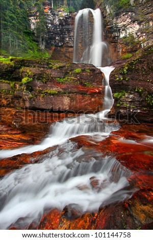 Beautiful Virginia Falls in the forests of Glacier National Park in northern Montana - stock photo