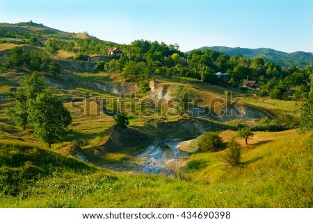 Beautiful vivid and amazing landscape from romanian countryside - stock photo