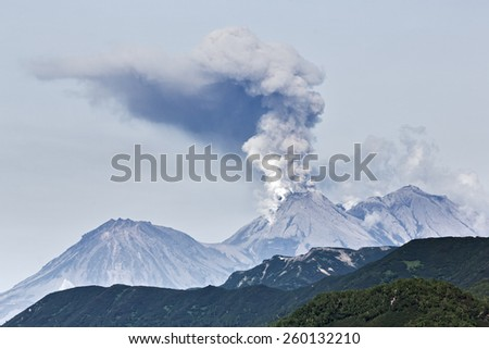 Beautiful volcanic (mountain) landscape of Kamchatka: eruption active Zhupanovsky Volcano on Kamchatka Peninsula (Russia, Far East). - stock photo