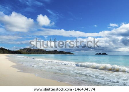 Beautiful Waimanalo and Bellows Beach with the Koolau Mountains and Mokulua islands in the distance - stock photo