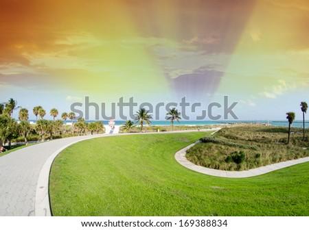 Beautiful walkway in the park along ocean, Miami. - stock photo