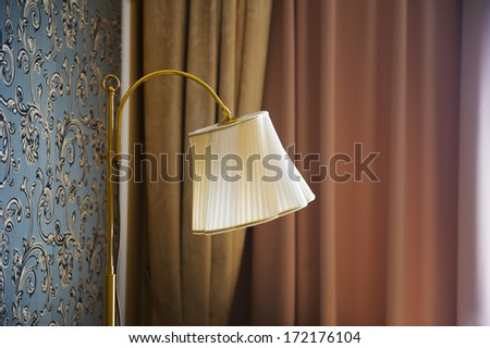 Beautiful wall lamp in the room - stock photo