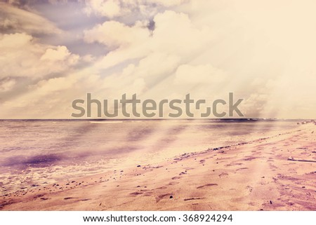 Beautiful water of the ocean and mountain background, summer beach, rocks on the ocean shore.