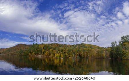 Beautiful water reflection landscape, displaying Vermont autumn foliage colors. Panorama view landscape along route 100 Vermont, USA. - stock photo