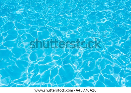 Beautiful water surface in swimming pool with sun reflection - stock photo
