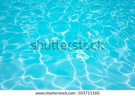 Beautiful water surface in swimming pool with sun reflection