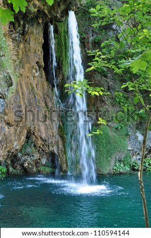 Beautiful waterfall and a turquoise lake in Plitvice, Croatia - stock photo
