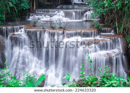 beautiful waterfall and green forest Resting Place and relax time - stock photo