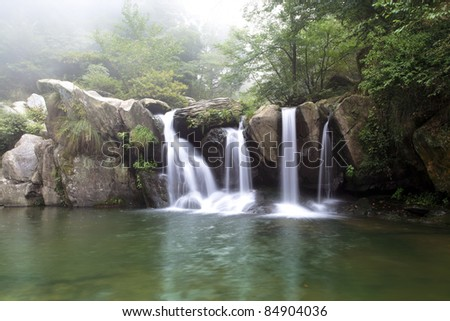 beautiful waterfall at the black dragon pool in lushan,China - stock photo