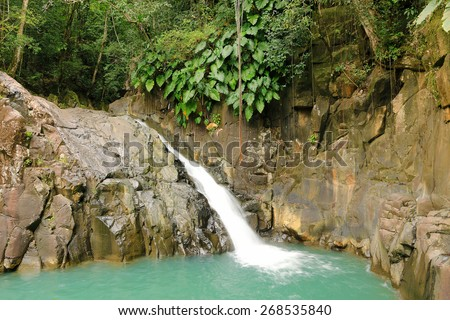 Beautiful waterfall in a rainforest. Saut d'Acomat, Guadeloupe, Caribbean Islands, France  - stock photo