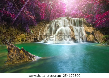 Beautiful waterfall in autumn forest, deep forest waterfall, Kanchanaburi province, Thailand - stock photo