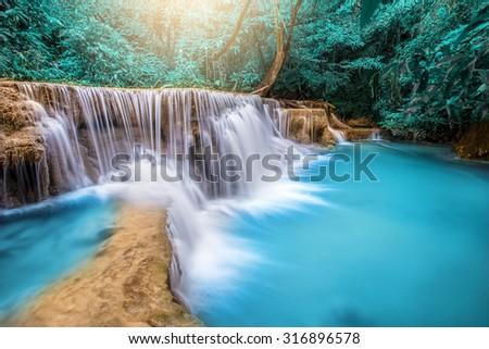 Beautiful waterfall in autumn forest, deep forest waterfall, Kanchanaburi province, Thailand - stock photo