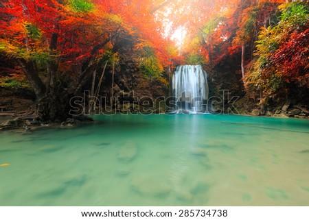 Beautiful waterfall in deep forest, Erawan National Park in Kanchanaburi, Thailand - stock photo