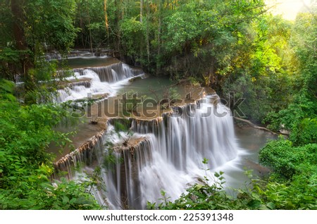 Beautiful waterfall in deep forest with soft focus - stock photo