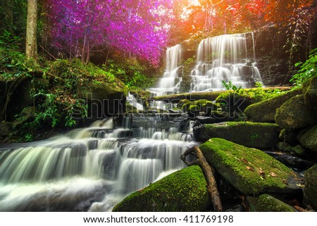 beautiful waterfall in green forest in jungle at phu tub berk mountain , phetchabun , Thailand - stock photo