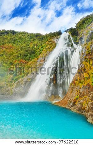 Beautiful waterfall in New Zealand - stock photo