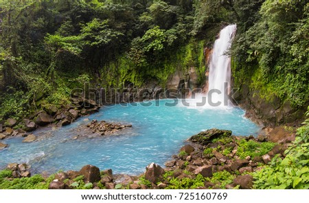 Beautiful waterfall in northern Costa Rica inside the Tenorio National Park with a bright turquoise color in the water