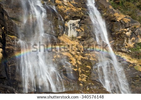 Beautiful waterfall in the forest with rainbow - Acquafraggia, Valtellina, Italia