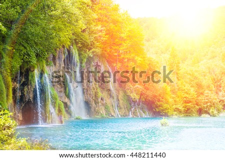 Beautiful waterfall landscape. Scenic cascade with lake and forest for travel, outdoor activity and spring, summer, autumn vacation. - stock photo