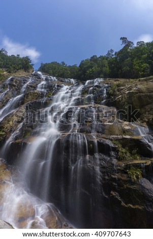 Beautiful Waterfall Located at Chemerong Berembun Langsir, Dungun, Terengganu, Malaysia. Taken with Long Exposure. Soft Focus and Motion Blur due to Long Exposure Shot