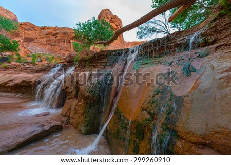 Beautiful Waterfall on Coyote Gulch Trail Escalante National Utah - stock photo