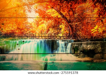 beautiful waterfall with day noon light in autumn forest on wooden texture, abstract background to happiness of nature.vintage color tone,with filter color effect. - stock photo