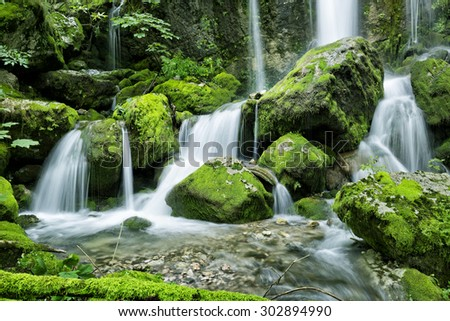 Beautiful waterfall with several cascades in the forest in Julian Alps mountains
