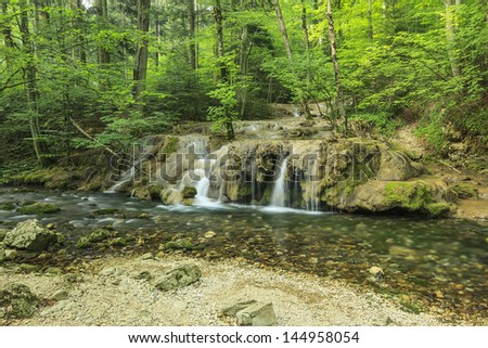 Beautiful waterfalls and babbling brook in forest,Beusnita National Park,Romania