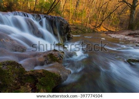 Beautiful waterfalls and mountain stream in Transylvania, in early spring