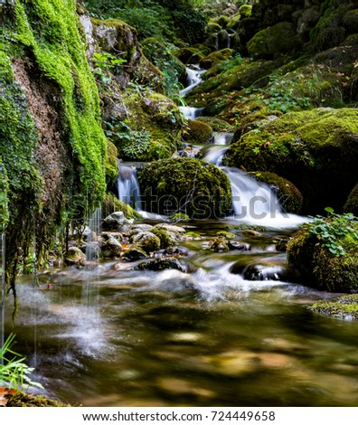 Beautiful waterfalls, the source of the Solotusa river on Mountain Tara in Serbia, National Park Bajina Basta. Clear waterfalls and beautiful stones covered with green moss in untouched nature.
