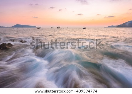 beautiful wave breaking and colourful seascape at coastline at Phuket Thailand - stock photo