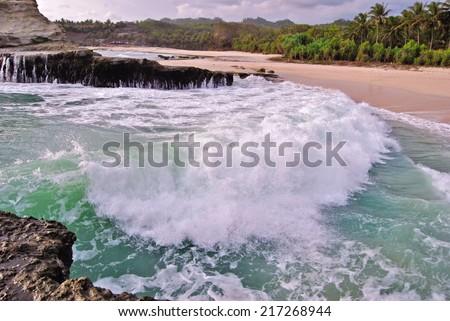 Beautiful waves, Indian ocean Klayar beach, Indonesia Java - stock photo