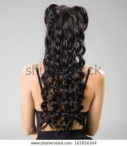 beautiful wavy hair on female back - stock photo