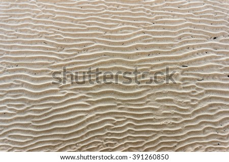 Beautiful wavy sand texture. Sand dunes, rippled sand formations. Summer sand background texture - stock photo