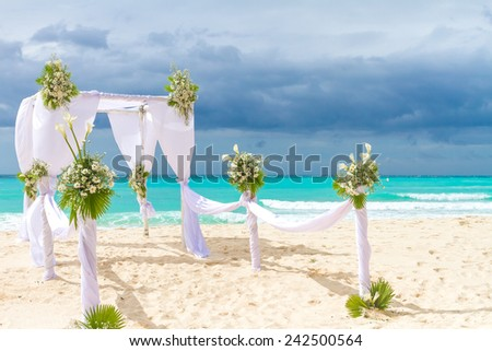 beautiful wedding arch, cabana on sand beach, outdoor beach wedding - stock photo