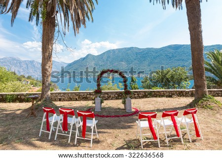 beautiful wedding arch for the ceremony of flowers. - stock photo