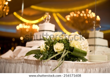 Beautiful wedding bouquet and cake - stock photo
