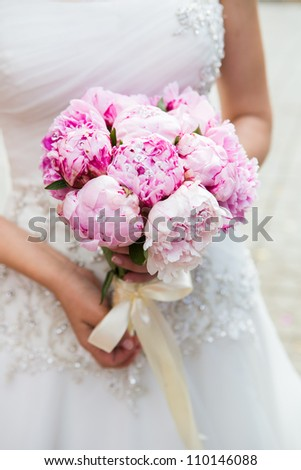 Beautiful wedding bouquet in bride's hand - stock photo