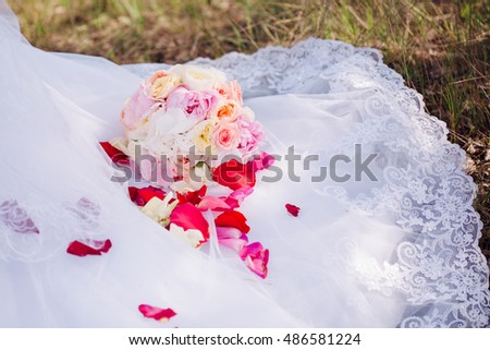 Beautiful wedding bouquet in hands of a bride
