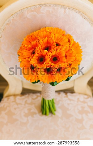 Beautiful wedding bouquet of orange flowers. No people. Vertical color photo. - stock photo