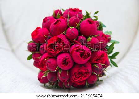 Beautiful wedding bouquet of red roses. - stock photo
