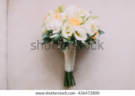 Beautiful wedding bouquet of white and pale peach roses