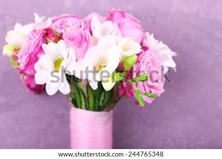 Beautiful wedding bouquet on wooden background - stock photo