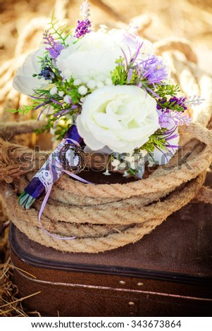 Beautiful wedding bouquet with flowers on nature background - stock photo